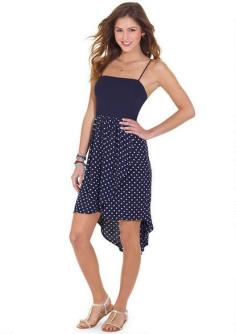 Navy Polka Dot Hi-Lo Dress - Sleeveless polka dot skirt dress with high-low hemline detail. Adjustable straps for better fit. Poly-spandex XS-XL 34'' long Imported