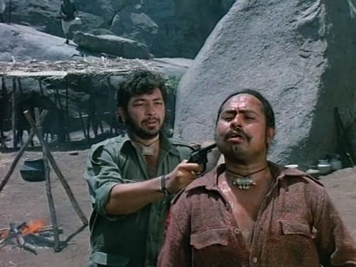 Gabbar plays 'Russian roulette' with one of his men who failed the mission.