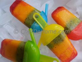 Tri-Color Fruit Ice Pops are so colorful fresh summer treat. Summers have brought so much heat this July, all we want is something to cool down.