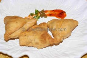 A famous authentic Indian snack, Samosas are prepared and liked in almost all parts of world these days. They're a lovely snack for a rainy cold day... We share with you step by step recipe to make de