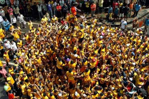 Devotees form a human pyramid to reach a clay pot containing butter during the celebrations of  Janmashtami in Mumbai August 14, 2009. Janmashtami marks the birthday of Hindu Lord Krishna.