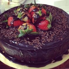 fresh strawberry toppings on a chocolate cake