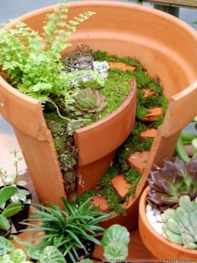 creativity.. making use of a broken flower pot