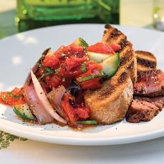 Panzanella Salad - Tomatoes, onions, cucumbers, and basil paired with grilled Italian bread make a great side to chicken or steak for your next meal.