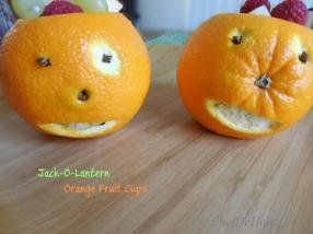 Jack-o-Lanterns Orange Fruit Cups are healthy and fun snack for kids during - all candy - Halloween days.