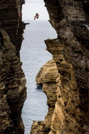 Blake Aldridge dives 29 metres from the rock monolith during the Red Bull Cliff Diving World Series in Portugal.