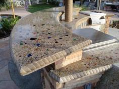 This outdoor bar features a cast-in-place concrete counter top with embedded glass and fiber optic lighting. - by landscape designer Scott Cohen on hgtv.com