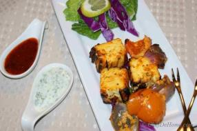 This is an easy recipe for Paneer Tikka - Paneer marinated in yogurt and spices and then grilled or baked in Conventional Oven Or traditional Indian Tandoor.