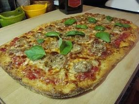 Thin Crust Pizza with Italian Sausage and Fresh Garlic