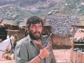 Gabbar holds a Smith and Wesson MP revolver