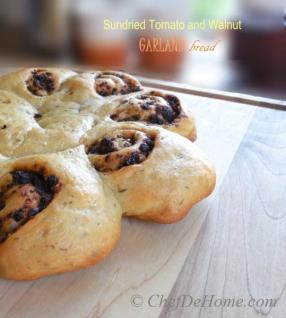 Very festive and homey, gutsy and intense flavored, this beautiful bread is a must bake for family and friends during holidays. Today, I am sharing Sun-Dried Tomato and Walnut Garland Bread.